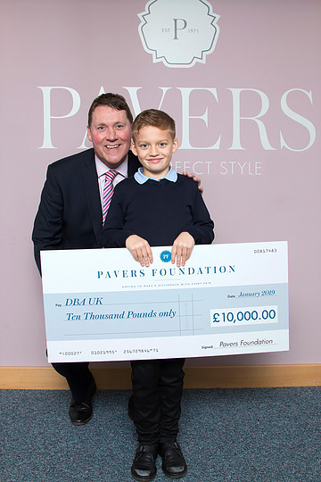 Mark Granger, Director of Operations at Pavers Shoes and member of The Pavers Foundation Committee with William Rhodes.