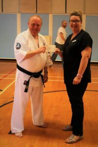 Sensei Gareth Rowlands with Ellen Hagland, Customer Advisor at Ebbw Vale.
