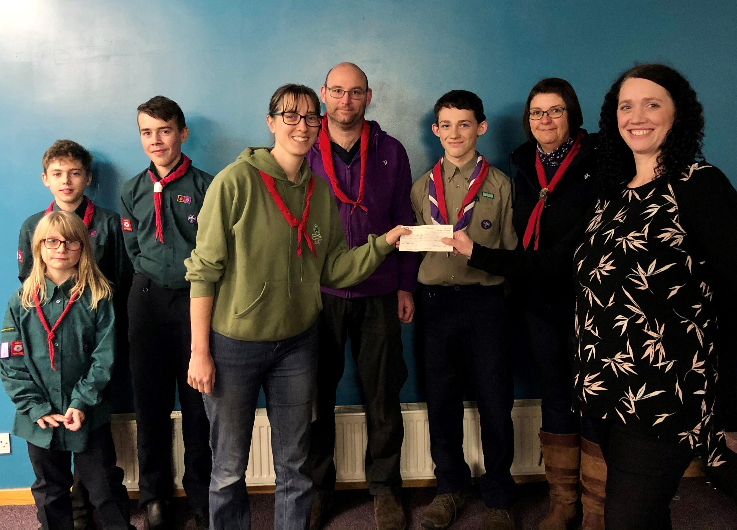 2nd Acomb Scout Group receiving the cheque from Claire Breen, Assistant Manager at Pavers in York.