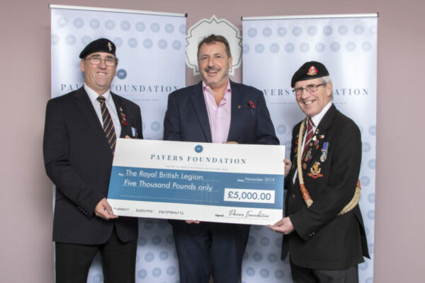 Volunteers from The Royal British Legion's Poppy Appeal receiving the donation cheque from Stuart Paver