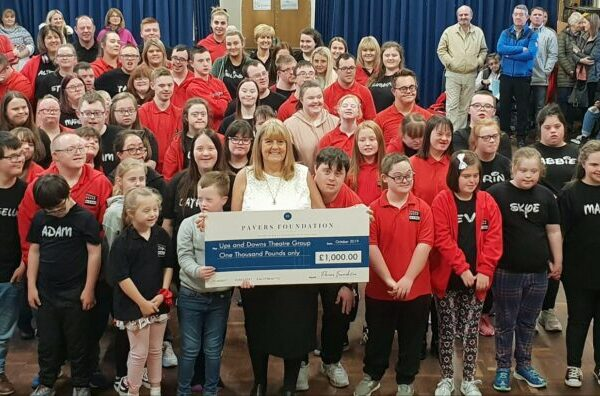 The Ups and Downs Theatre Group receiving the cheque