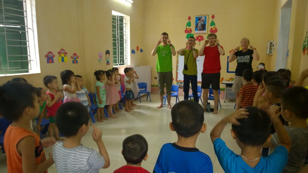 Volunteers teaching local primary school children