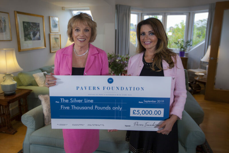 Dame Esther Rantzen , Founder of The Silver Line receiving the cheque from Debbie Paver, Trustee of the Pavers Foundation
